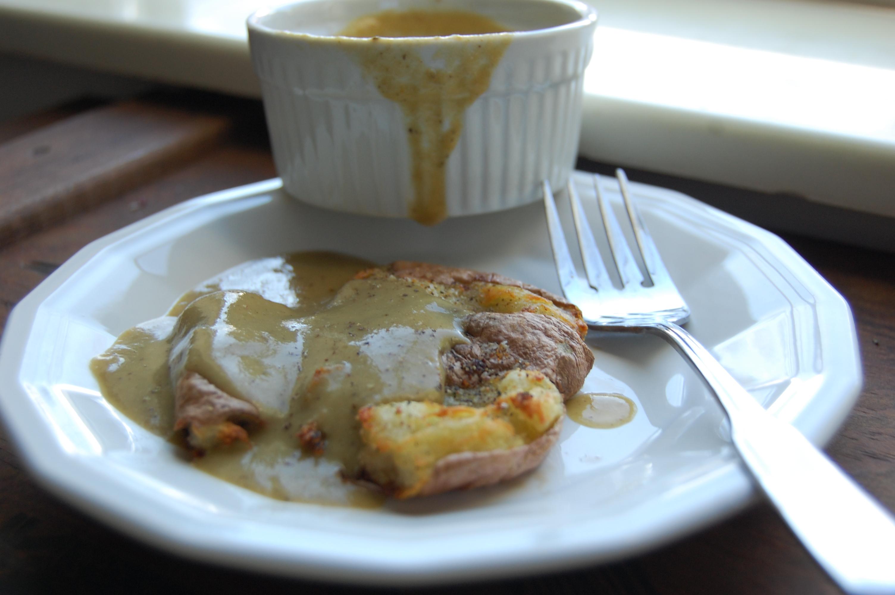 The proper way to eat gravy. Smothering a crispy smashed potato.