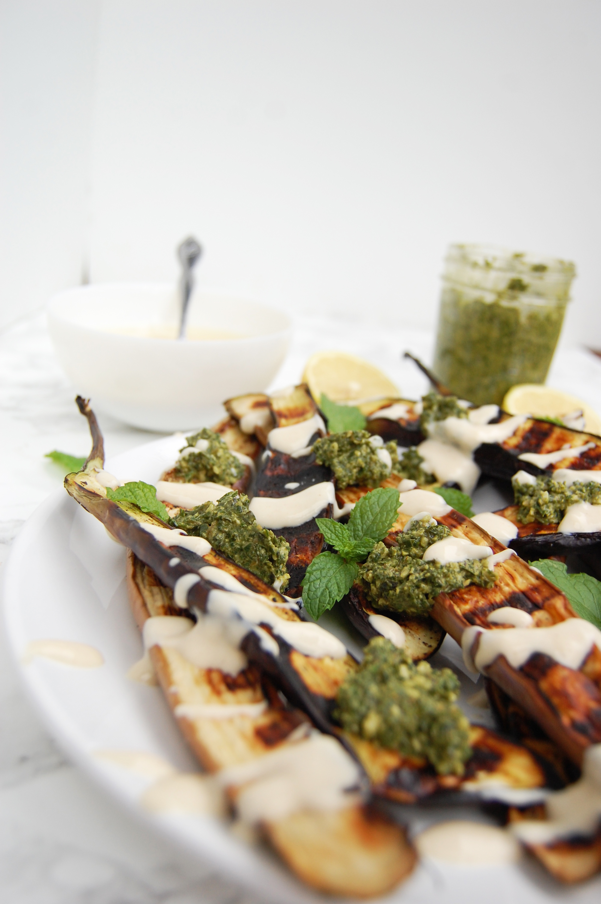 Grilled Eggplant with Pesto + Yogurt Tahini Sauce | AreYouKitchenMe.com
